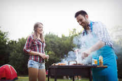 Friends enjoying bbq party stock photography