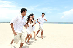 Friends Enjoying Beach Together Stock Photography