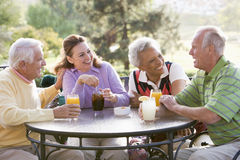 Friends Enjoying A Beverage By A Golf Course royalty free stock image