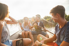 Friends Enjoying On A Boat Royalty Free Stock Photo