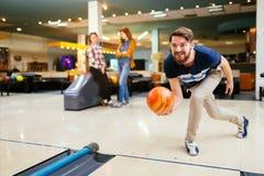 Friends enjoying bowling at club. Friends enjoying recreational  bowling at club Stock Photography