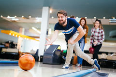 Friends enjoying bowling at club. Friends enjoying recreational  bowling at club Stock Photo