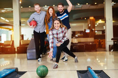 Friends enjoying bowling at club. Friends enjoying recreational  bowling at club Stock Images