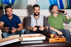 Friends enjoying boy's night at home Stock Photos