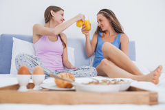 Friends enjoying breakfast in bed Stock Photos