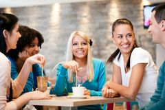 Friends enjoying coffee together Stock Images
