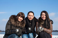 Friends enjoying a cup of hot drink Royalty Free Stock Photography