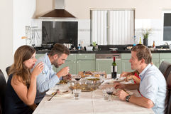 Friends enjoying dinner at home royalty free stock photography
