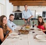 Friends enjoying dinner at home Stock Image