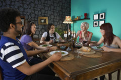 Friends Enjoying Dinner Party. Group of multiethnic friends enjoying dinner party Royalty Free Stock Images