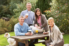 Friends Enjoying Drink In Pub Garden. Group Of Friends Outdoors Enjoying Drink In Pub Garden Royalty Free Stock Photography