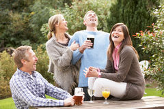 Friends Enjoying Drink In Pub Garden Royalty Free Stock Photo