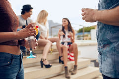 Friends enjoying drinks during rooftop party Royalty Free Stock Image