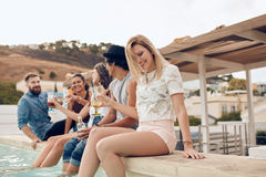 Friends enjoying drinks during rooftop party Stock Photography