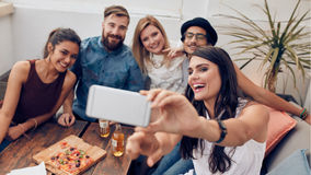 Friends enjoying drinks during rooftop party Stock Photo