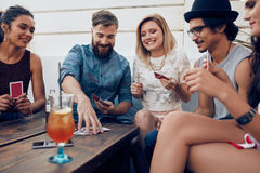 Friends enjoying drinks during rooftop party Royalty Free Stock Photos