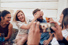 Friends enjoying drinks during rooftop party Royalty Free Stock Photography