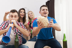 Friends enjoying football game Stock Photos