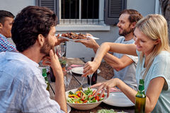 Friends enjoying garden party Royalty Free Stock Images