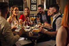 Friends Enjoying A Meal stock photography