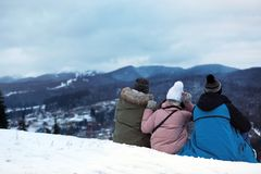 Friends enjoying mountain landscape, space for text. Winter vacation royalty free stock photography
