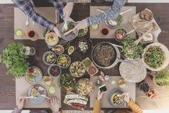 Friends enjoying new vegetarian recipes Royalty Free Stock Images