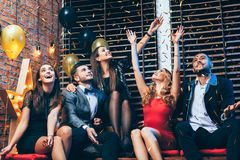 Friends enjoying party and having fun throwing confetti. Group of friends enjoying party and having fun throwing confetti. New year, Birthday, Holiday Event Royalty Free Stock Photo