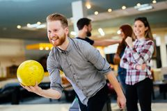 Friends enjoying bowling at club Stock Photography