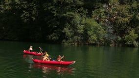 Friends enjoying riding canoe on river stock video footage
