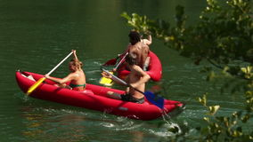 Friends enjoying riding canoe on river stock video