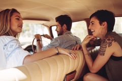 Friends enjoying on a road trip Stock Image