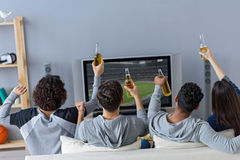 Friends enjoying soccer in TV royalty free stock photo