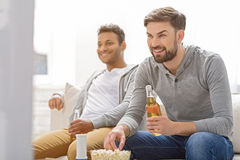 Friends enjoying soccer in TV royalty free stock image