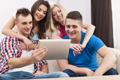 Friends enjoying tablet Stock Photos