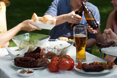 Friends enjoying themselves on garden party royalty free stock photos