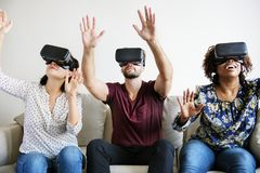 Friends enjoying VR experience together royalty free stock photos