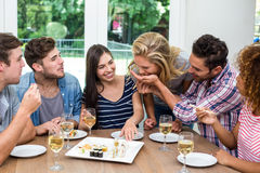 Friends enjoying wine and sushi at home Stock Image