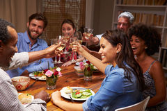 Friends at an evening dinner party Royalty Free Stock Photo