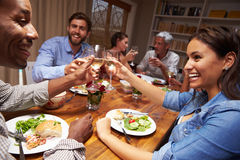 Friends at an evening dinner party Stock Photos