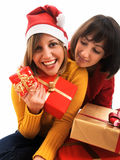 Friends exchanging christmas presents. Isolated on white background Royalty Free Stock Image