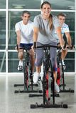 Friends On Exercise Bikes Royalty Free Stock Image