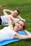 Friends Exercising In Park Royalty Free Stock Photo