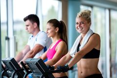 Friends  exercising on a treadmill at the bright modern gym Stock Photos