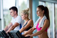 Friends  exercising on a treadmill at the bright modern gym Stock Images