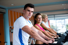 Friends  exercising on a treadmill at the bright modern gym Stock Photo