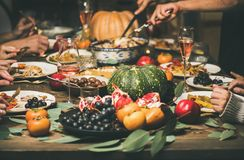 Friends or family eating different snacks at Festive Christmas table. Traditional Christmas or New Year holiday celebration party. Friends or family eating royalty free stock images