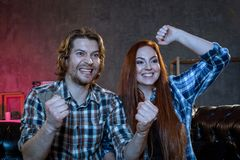 Friends are fans of sports games as football, basketball, hockey royalty free stock photography