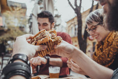 Friends In Fast Food Restaurant. Hipster Friends In Fast Food Rastaurant Eating Burgers Stock Photo