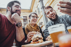 Friends In Fast Food Restaurant stock image