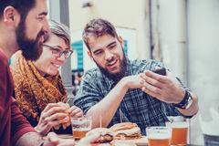 Friends In Fast Food Restaurant. Hipster Friends In Fast Food Rastaurant Taking Selfie Royalty Free Stock Photography